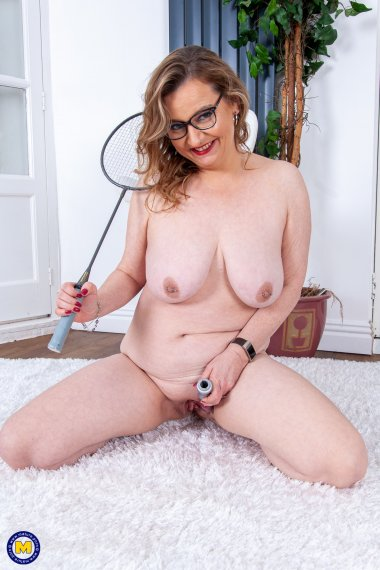 Naughty cougar playing with her wet pussy at home