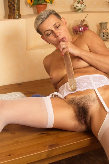 Hairy housewife playing with her duster