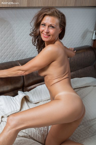 Sexy tanlined mature babe Drugaya naked on her bed.