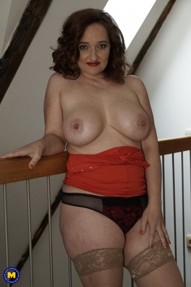 Big breasted MILF playing with her pussy in the hallway
