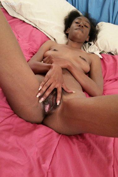 Ebony MILF Chiyoki masturbates with her favorite sex toy.