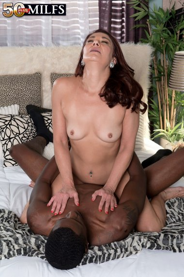 Mature housewife sucking a black cock