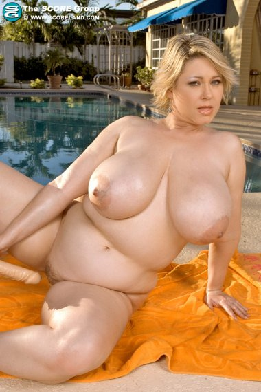 Blonde mature with huge breasted playing with herself
