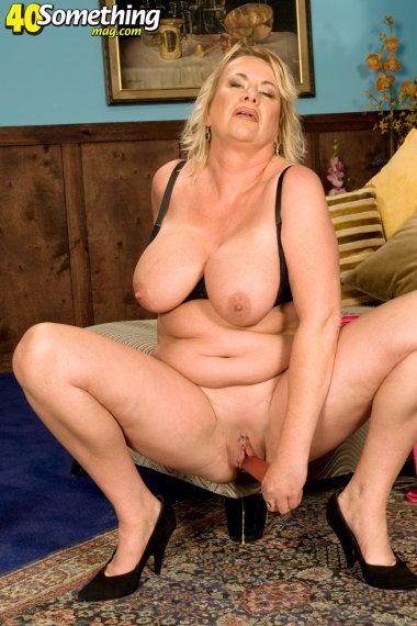 Horny housewife playing with her dildo