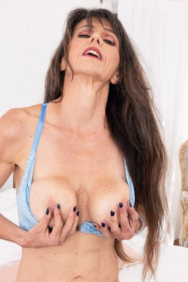 Hot older MILF playing with her big boobs