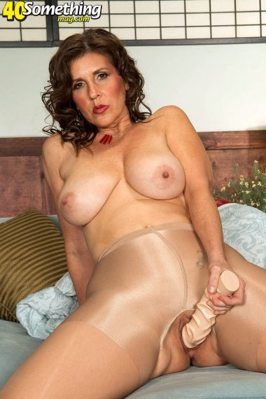 Naughty brunette housewife in pantyhose masturbate with a big dildo