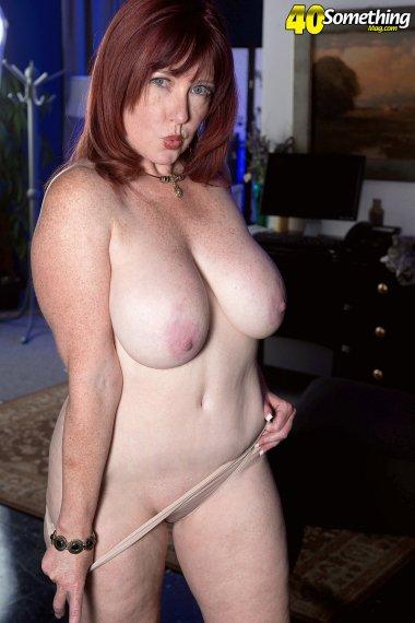 Sexy redhead MILF shows off her big boobs