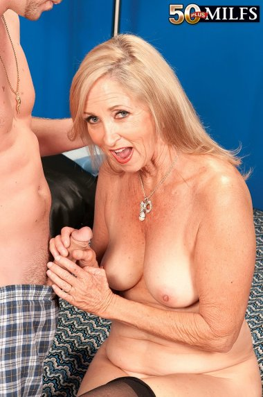Naughty housewife playing with her young toy boy