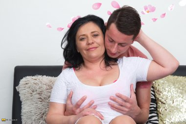 This horny mature lady loves to fool around with the guy next door
