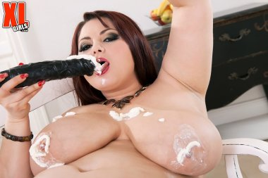 Brunette big boobed BBW playing with her dildo
