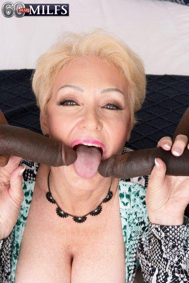 Blonde hot MILF sucking a two black cocks