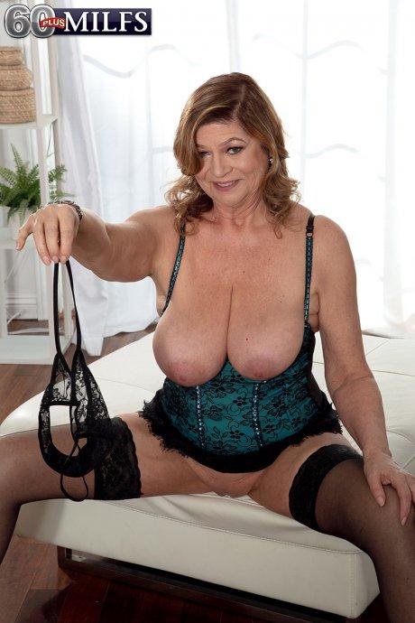 Big boobed mature housewife Brenda Douglas masturbate with a big dildo