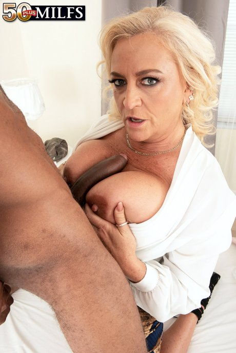Blonde big breasted MILF fucking with a black guy