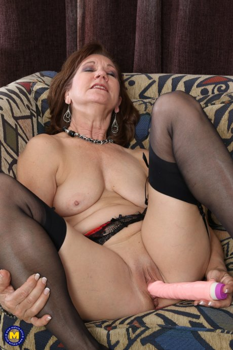 Naughty mature lady playing with her pussy