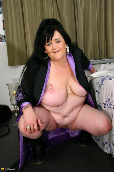 Big mama playing with her big tits and wet pussy
