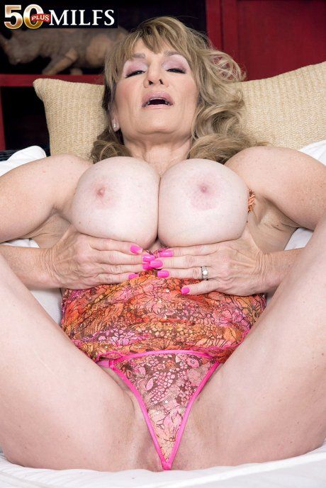 Hot big boobed MILF Roxy Royce playing with herself