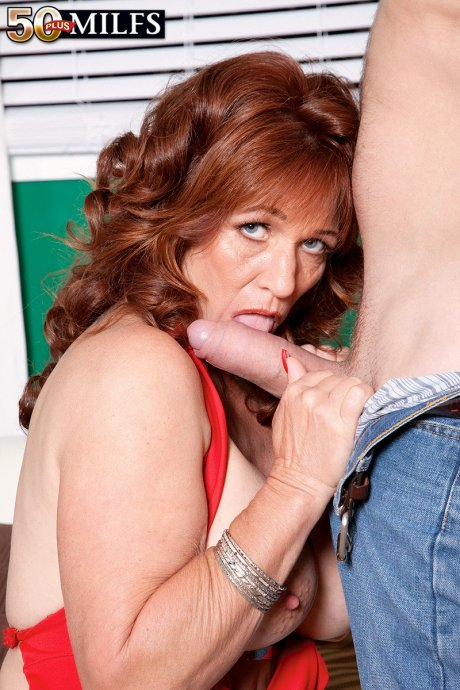 Very horny redhead MILF Sheri Fox get fucked by a younger guy