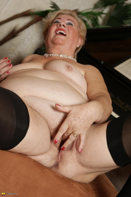 Blonde mature lady playing with herself