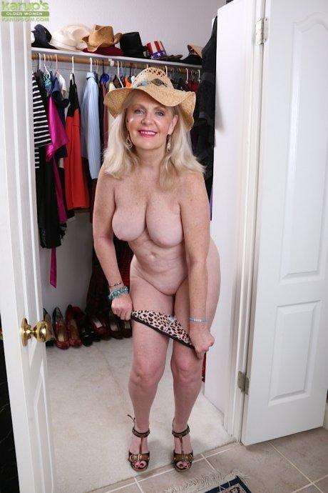 Busty older babe Judy Belkins spreads pussy in closet