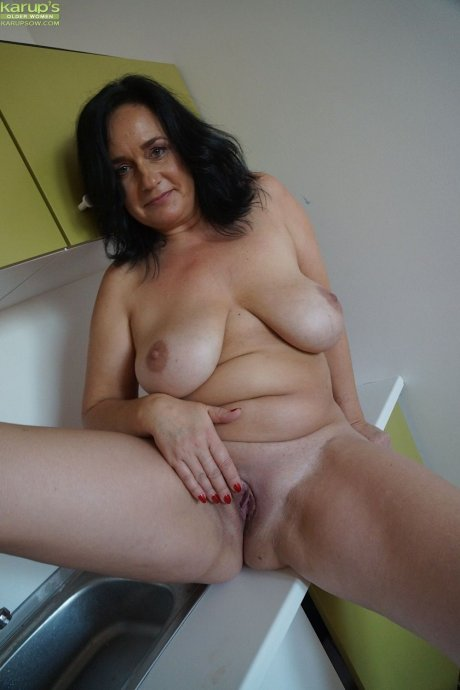 Mature housewife Ria Black gets naked on the kitchen counter