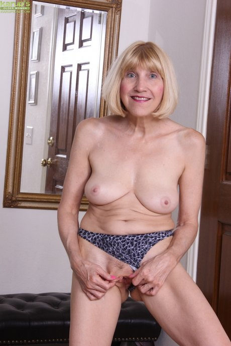 Horny business woman Bossy Ryder strips after work