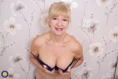 Naughty British housewife getting wet in her bedroom